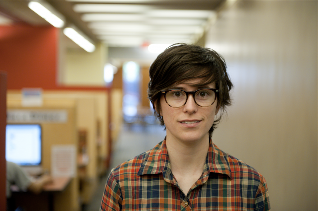 photo of caitlin standing in weigle information commons at penn